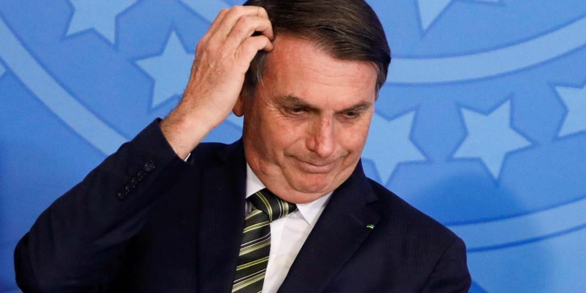 Brazil's President Jair Bolsonaro gestures during a review and modernization ceremony of occupational health and safety work at the Planalto Palace in Brasilia, Brazil July 30, 2019. REUTERS/Adriano Machado